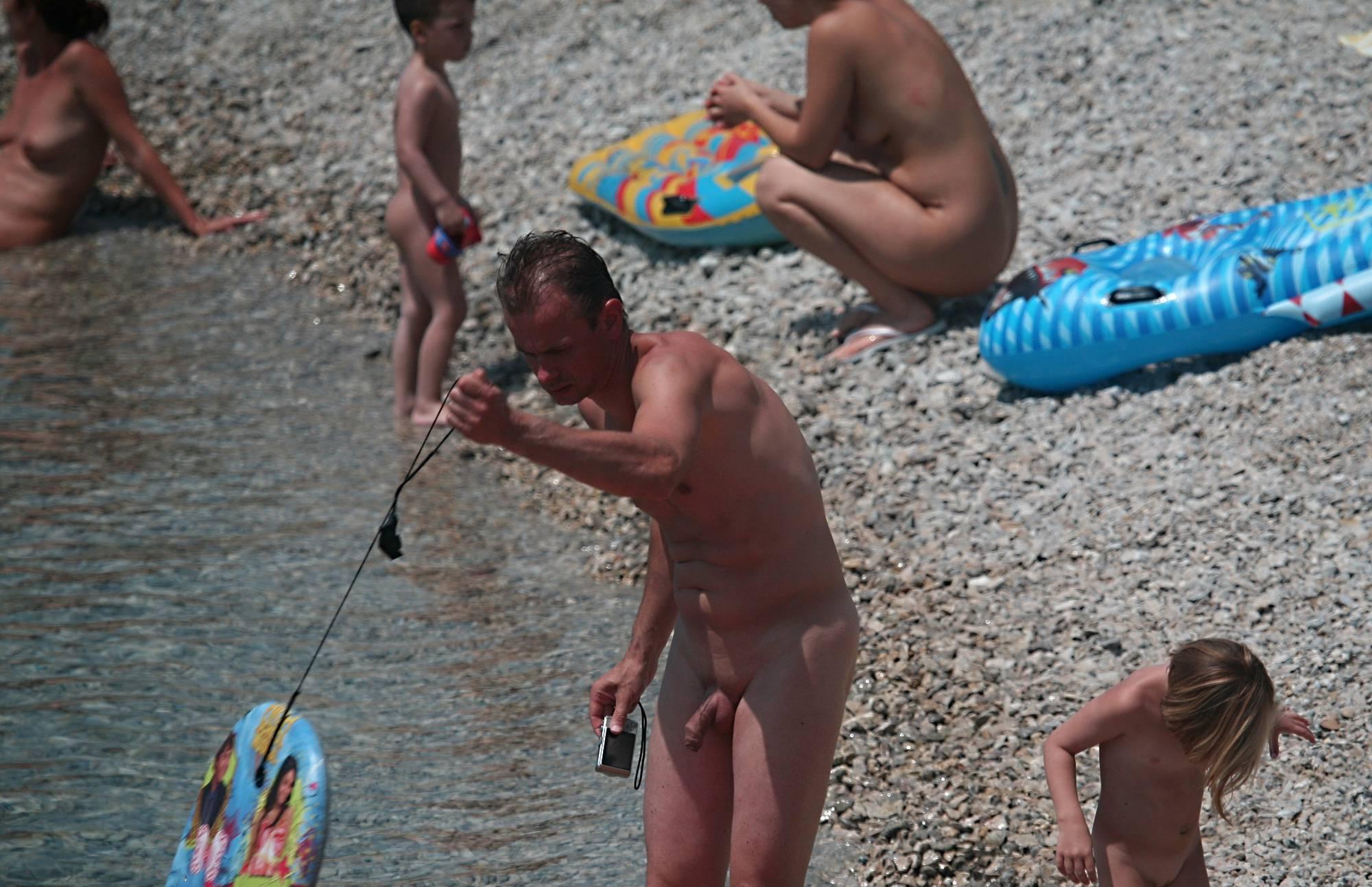 Nudist Gallery Babysitting Kids on Shore - 2