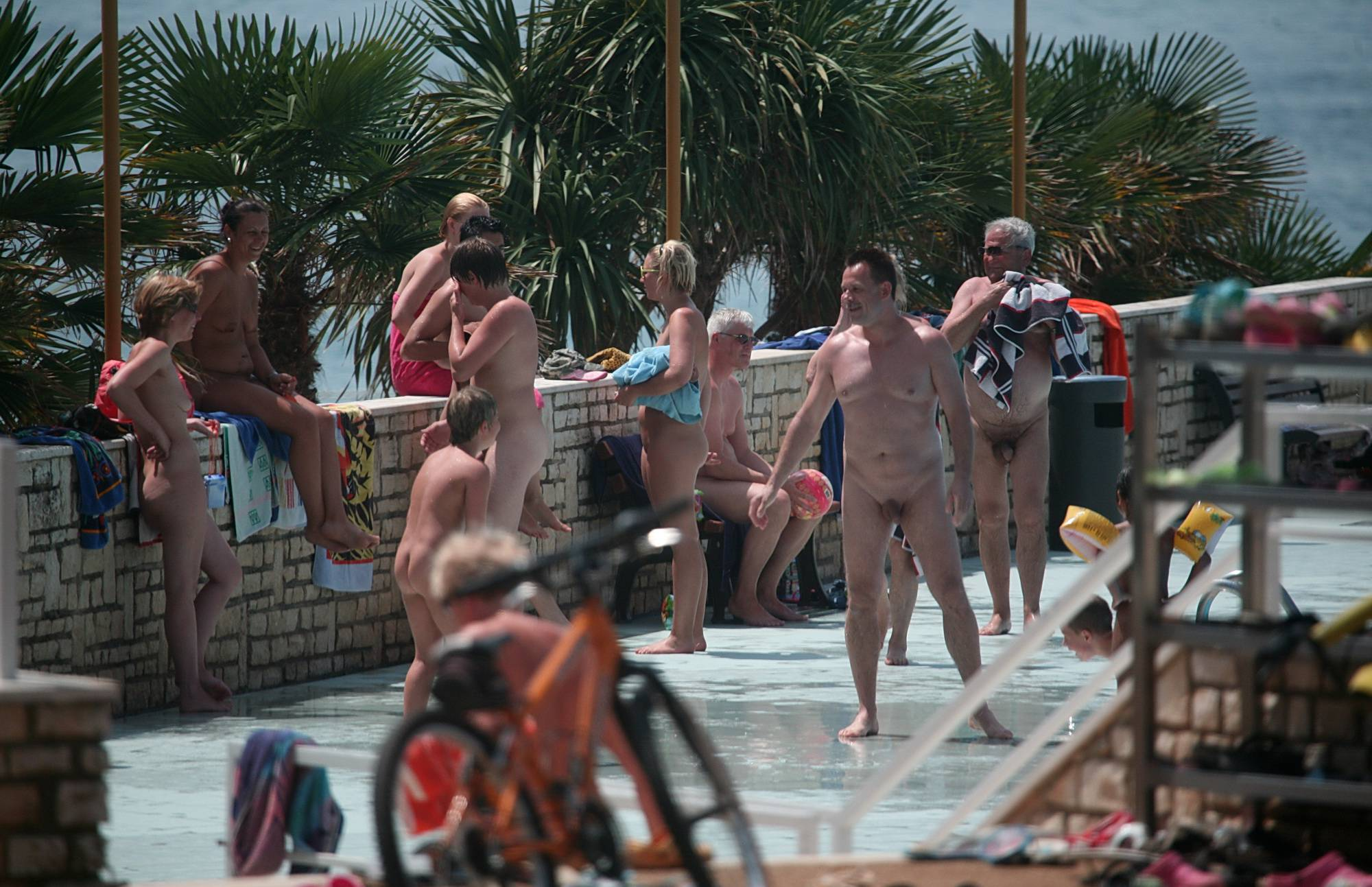 Nudist Pics Biking At Edge Of The Pool - 2