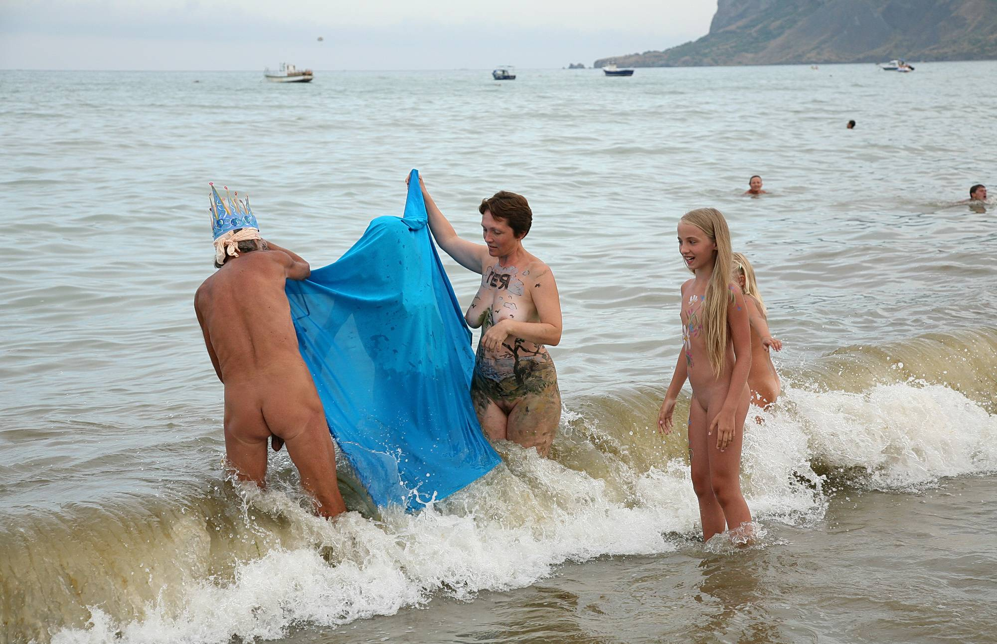 Nudist Pictures Wading Near The Coast - 1